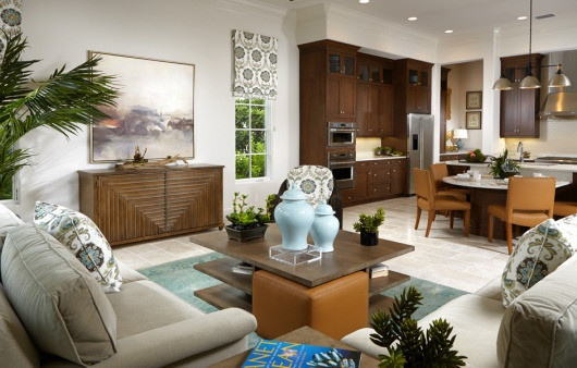 The family room and breakfast peninsula shows off the subdued and elegant interior design from Romanza.