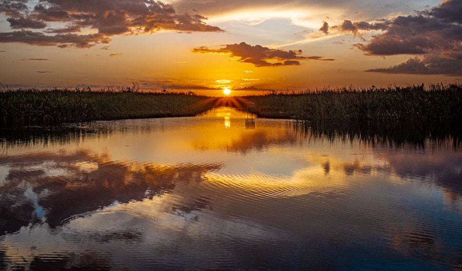sunset florida water trees nature freshwater saltwater clouds